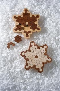 Cut a Pair of Challenging Snowflake Puzzles