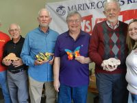 Pictured are Chuck Fleming of Toys for Tots, Claude Drevet, Terry Nicholson, Brian Beals, Cecil Schneider, and Amy Brannon-Hamby of Toys for Tots.