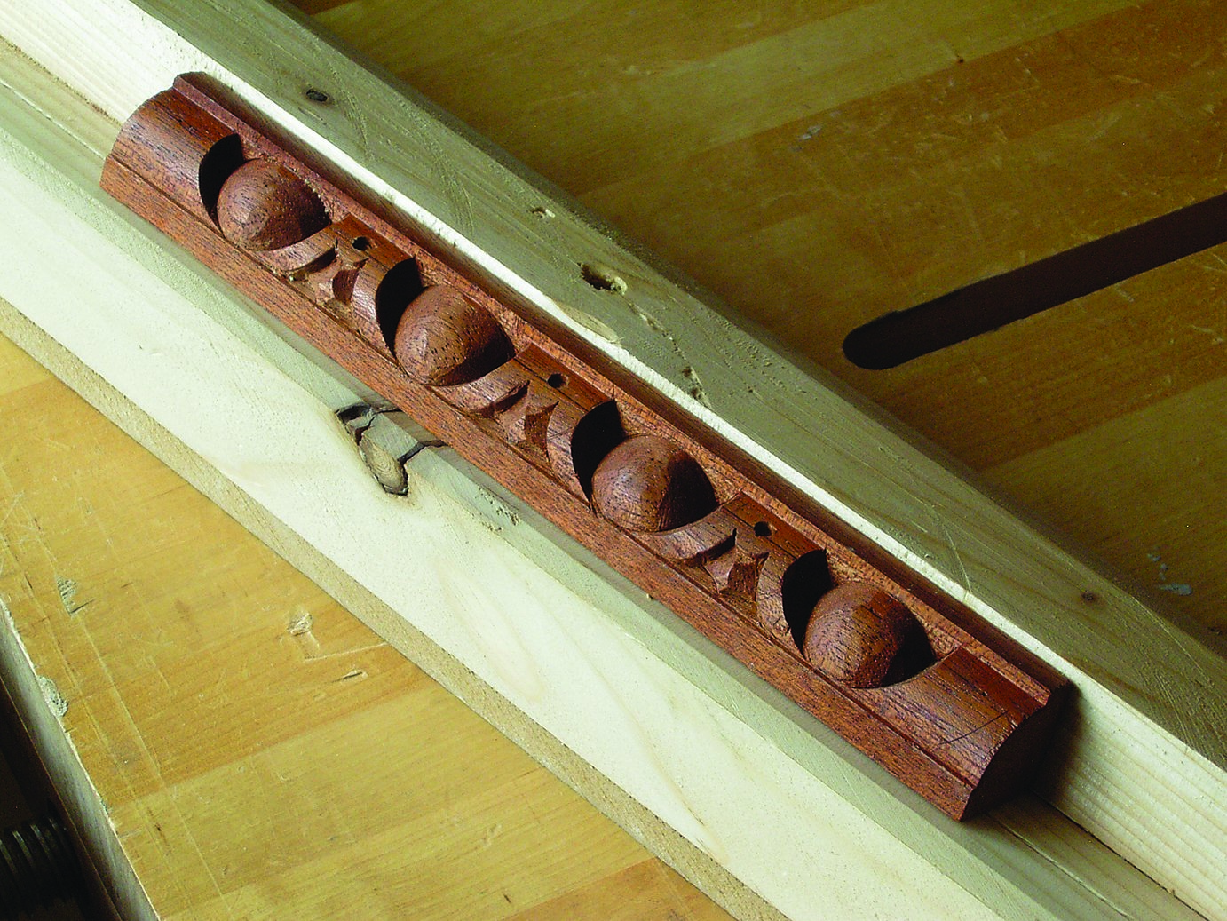 Moulding held in a jig and secured with double-sided tape.