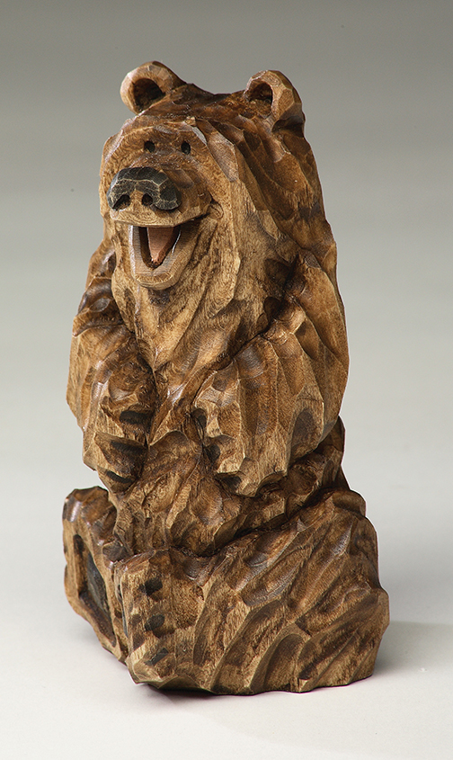 Laughing bear woodcarving illustrated
