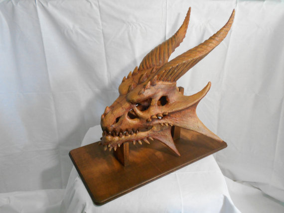 Wise old dragon skull woodcarving illustrated