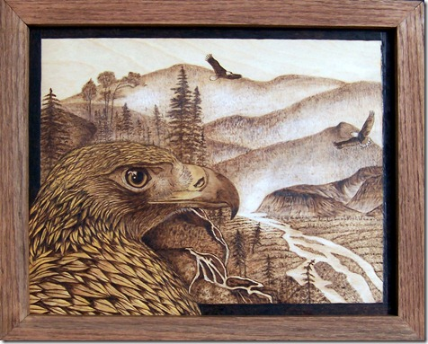 """Danette Smith's """"Eagle Territory"""" is one of many woodburned artworks in the 20th Century Pyrographers exhibit in Andrews, N.C."""