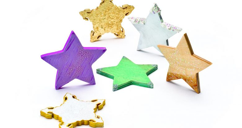 """Clockwise from left: Paint, glitter, and faux gilding; paint and crackle glaze; gold leaf; paint, modeling paste """"snow,"""" and glitter; gloss poly and glitter; Glimmer Glaze  and glitter."""