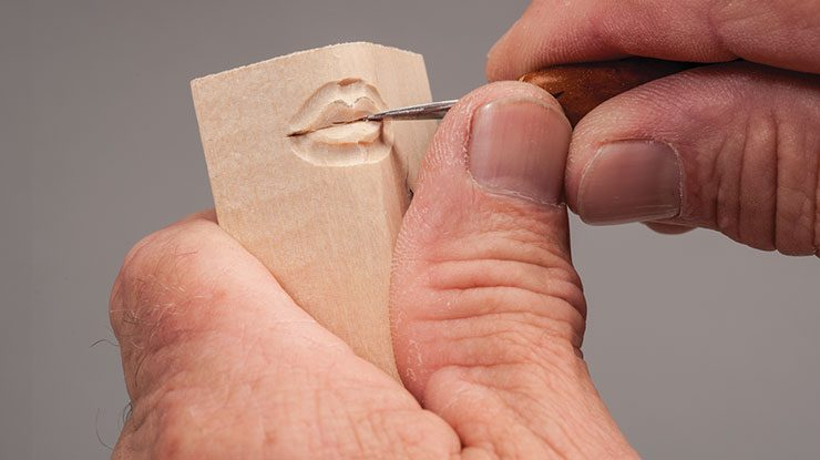 Carving a Woman's Mouth